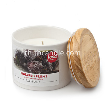 pouring scented candles in white ceramic container with wooden lid