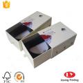 Rigid cardboard sliding gift box with ribbon