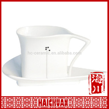 HCC coffee cup and oval saucer, giant cup and saucer
