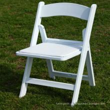 Cadeira de dobradura acolchoada branca da resina da cadeira de dobradura do casamento da resina dos PP
