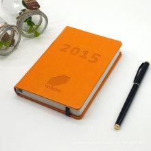 Schreibtisch-Spitzenagenda mit Stift-Notizbuch mit Stift