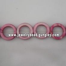 purple donut shape fresh water shell beads