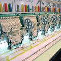Machine à broder la lentille à tête multicolore