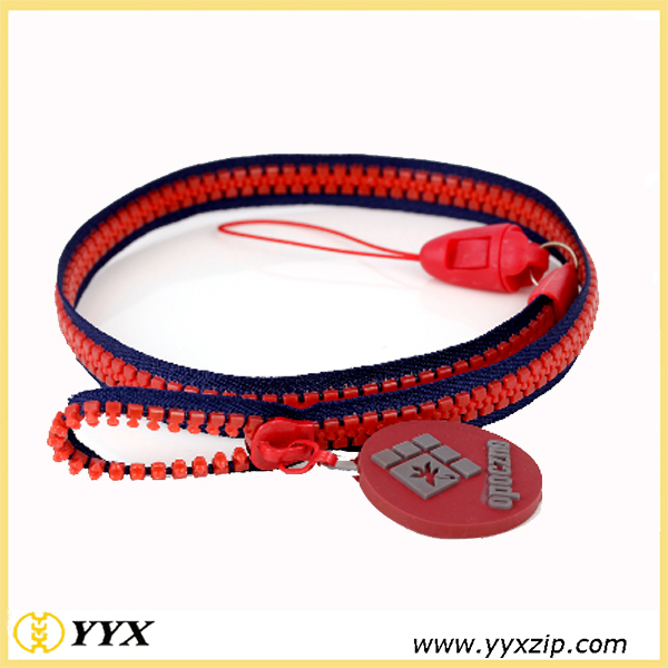 Blue edge, red teeth zip-lanyard