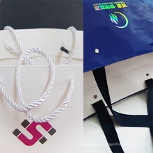Bolsa de papel de regalo de compras impresas al por mayor con asa