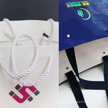 Оптовый бумажный пакет для подарков с принтом для покупок с ручкой