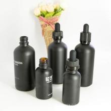Bouteille d'huile essentielle en verre avec une variété de capsules (NBG05)