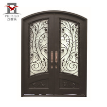 wrought iron and glass door with iron door handle