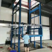 NOUVEAU matériel de construction plate-forme d'entrepôt élévateur Plate-forme élévatrice hydraulique pour rail de guidage