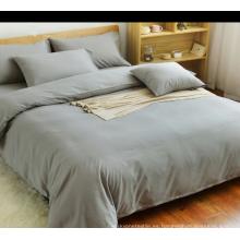 Tejido de poliéster de color sólido personalizado para juego de cama