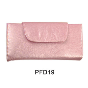 Pink satin pouch with peaked button for cosmetic kit