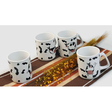 ceramic coffee mug with cow design