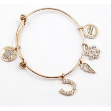 Bracelet en acier inoxydable plaqué or avec des charmes