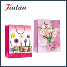 Papel revestido com flores bonitas Bolsa de papel para presente de compras à mão
