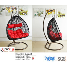 Outdoor hanging wicker swing chair for leisure time.
