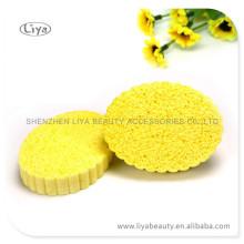 Желтый сжатый губки для мытья лица