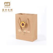 A cópia feita sob encomenda por atacado do design floral recicl a flor leva sacos de papel de empacotamento de Kraft do presente com punho