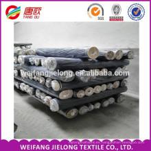Un grado del algodón del dril de algodón de los vaqueros del grado estira la acción barata de la tela del dril de algodón