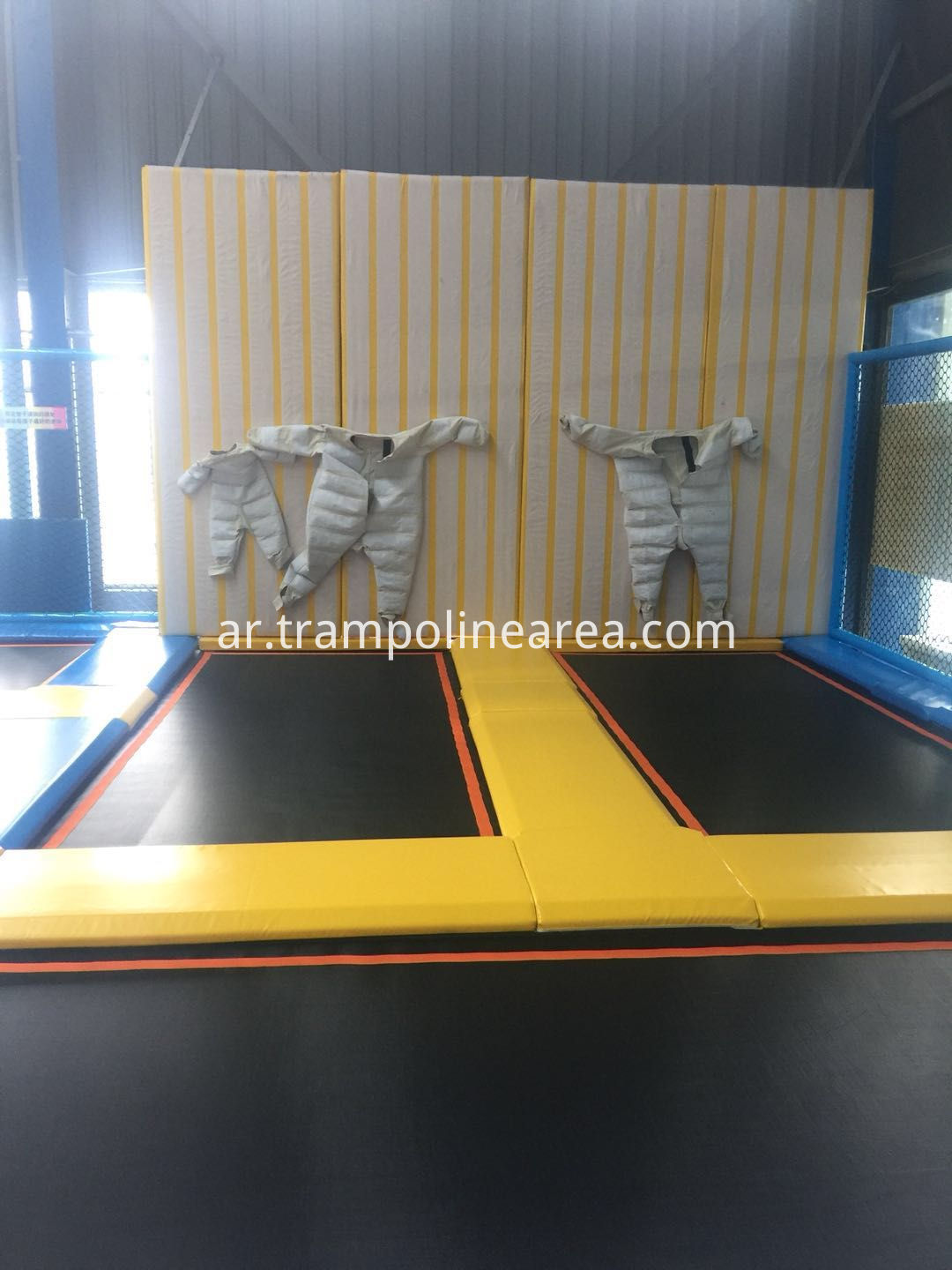 indoor trampoline park with spider wall