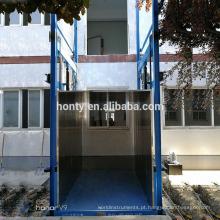 O fornecedor de China oferece o elevador hidráulico barato do elevador do armazém do elevador da carga do armazém hidráulico do trilho de guia