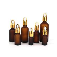 Custom empty 15ml 30ml 50ml 100ml frosted amber cosmetic glass essential oil dropper bottle