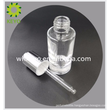 30ml Hot sale make up packing colored transparent empty cosmetic glass dropper bottle with press dropper