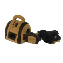 Cão de brinquedo de pelúcia e sua casa