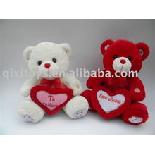 plsuh and stuffed Valentine teddy bear with heart