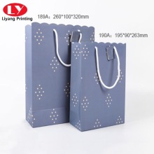 Solid color carrier portable paper bag with wavy