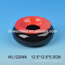 Ceramic ashtray in round shape
