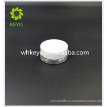 La venta caliente 5g compone el tarro de cristal cosmético vacío coloreado transparente del cilindro cosmético con el tapón de tuerca