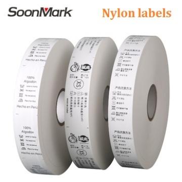 Rouleau d'étiquettes de soin de lavage de vêtement en satin de polyester 25 * 200