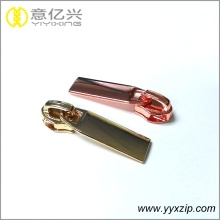 Hanging and rolling plating simple zipper pullers