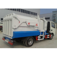 Side loader compression refuse truck