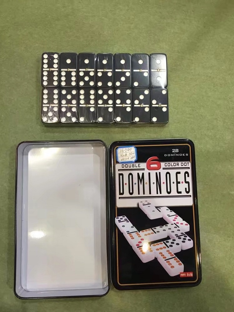 black dominoes in tin box