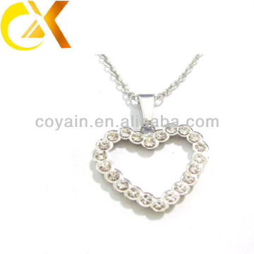 Fabricante 316L joyería de acero inoxidable forma de corazón colgantes de cristal para las mujeres