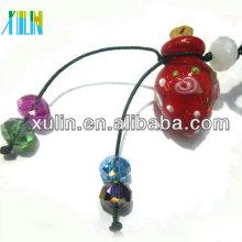Vente chaude rouge verre bouteille de parfum pendentif en bois perles d'animaux avec capuchon en bois