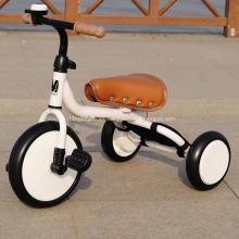 Triciclo de niños con manija de empuje