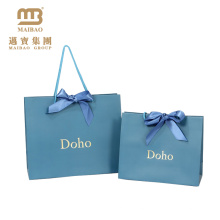 China Manufactures Wholesale Luxury Printed Gold Foil Logo Design Wedding Custom Paper Gift Bag With Handle