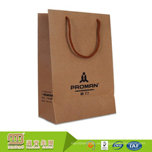 Diseño de logotipo personalizado reforzado muestra gratis Bolso de mano marrón de Kraft bolso de papel para embalaje de compras