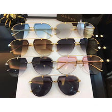 Модный дизайн Овальные солнцезащитные очки без оправы для женщин