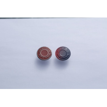 Botón a presión utilizado para ropa de mezclilla