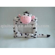 Marco de foto de juguete de vaca felpa y peluche