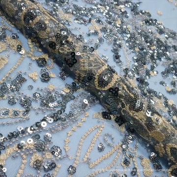 Dentelle brodée de perles paillettes sombres