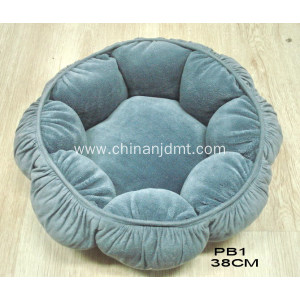 A dog's bed shape like a flower