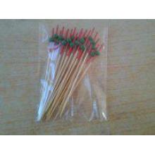 Красная головка с зеленой бусинкой из бамбука