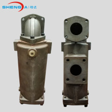 Cast inline oil filter housing and filter cartridge