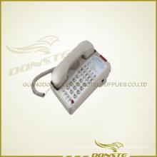 Teléfono con cable en la habitación
