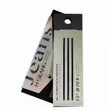 Thin and long black cardboard hang tag printer with hang tag rope