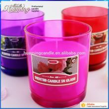 Glasgefäß-bunte fromme Kerze